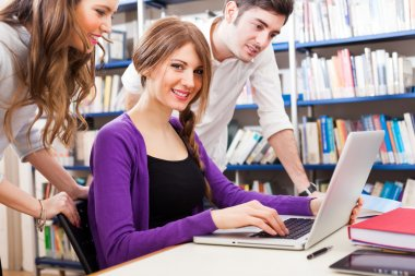 Students using a laptop