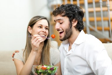 Woman lovely feeding her boyfriend