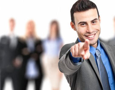 Smiling businessman pointing his finger