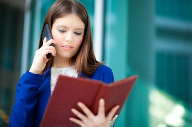 Businesswoman with phone and agenda