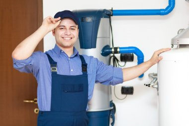 Smiling plumber at work