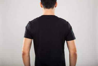 Back of man wearing a black t-shirt