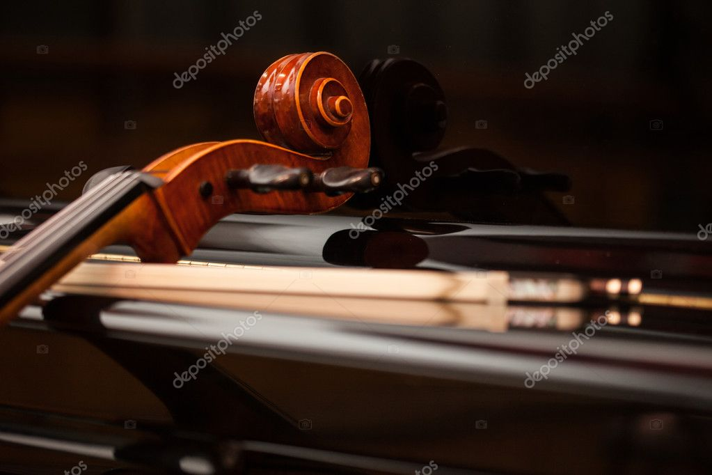 Cello leaning on a piano