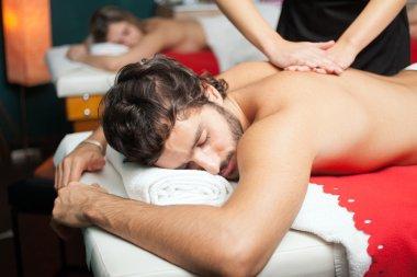 Handsome man having a massage stock vector