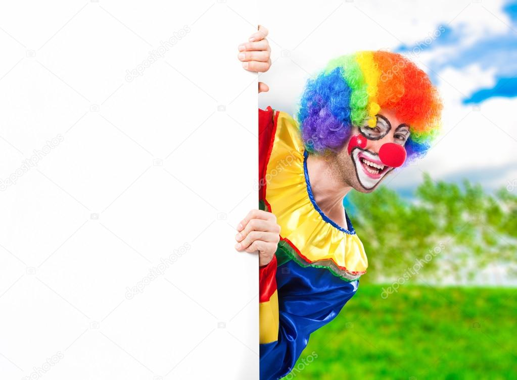 Clown holding a blank sign