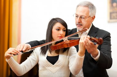 Violin teacher with a student