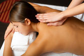 Woman getting a massage in a spa