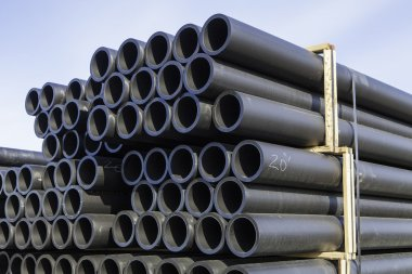 Stacks of plastic pipe