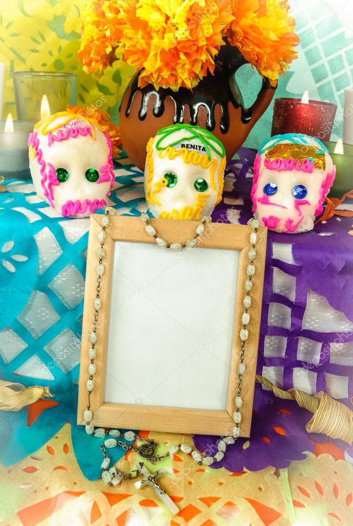Blank photo frame on a day of the dead altar (Dia de Muertos ...