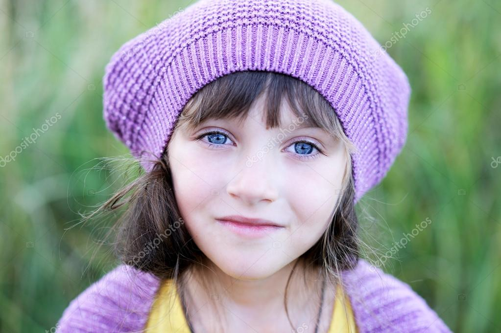 5e7c2df9222 Close-up portrait of little blue-eyed girl in violet hat — Photo by alinute