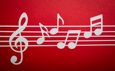 Paper cut of music note on staves with copy space for text or d