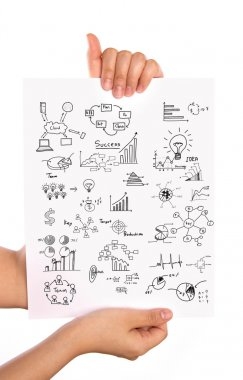 Hand hold Business concept and graph drawing on white paper
