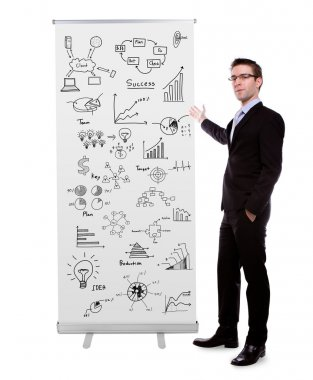 Business man showing roll up banner display with graph isolated