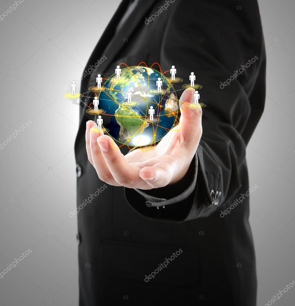 Business man holding the small world in his hands against white