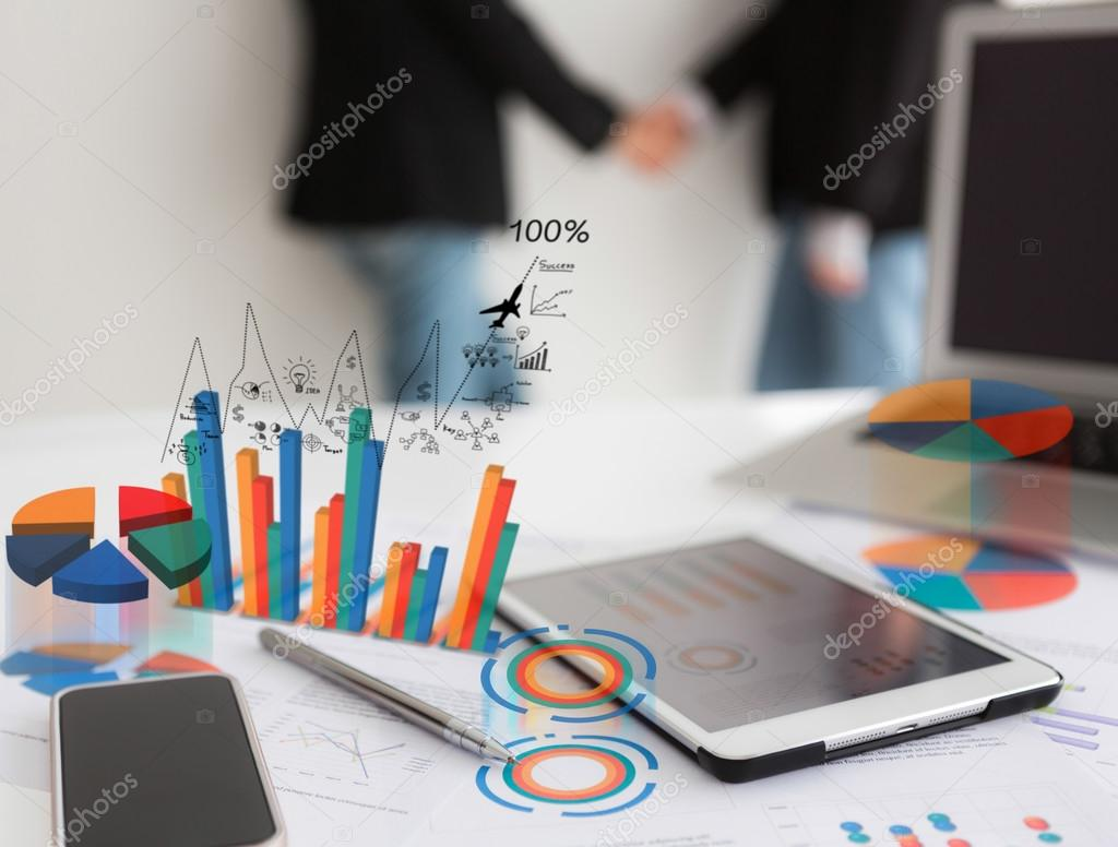 Close-up of business team using digital tablet with financial di