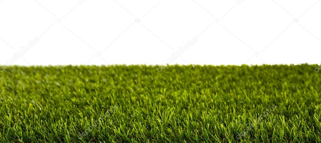 Artificial Fresh spring green grass panorama isolated on white b