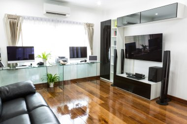 Modern office with computer and labtop with home theater