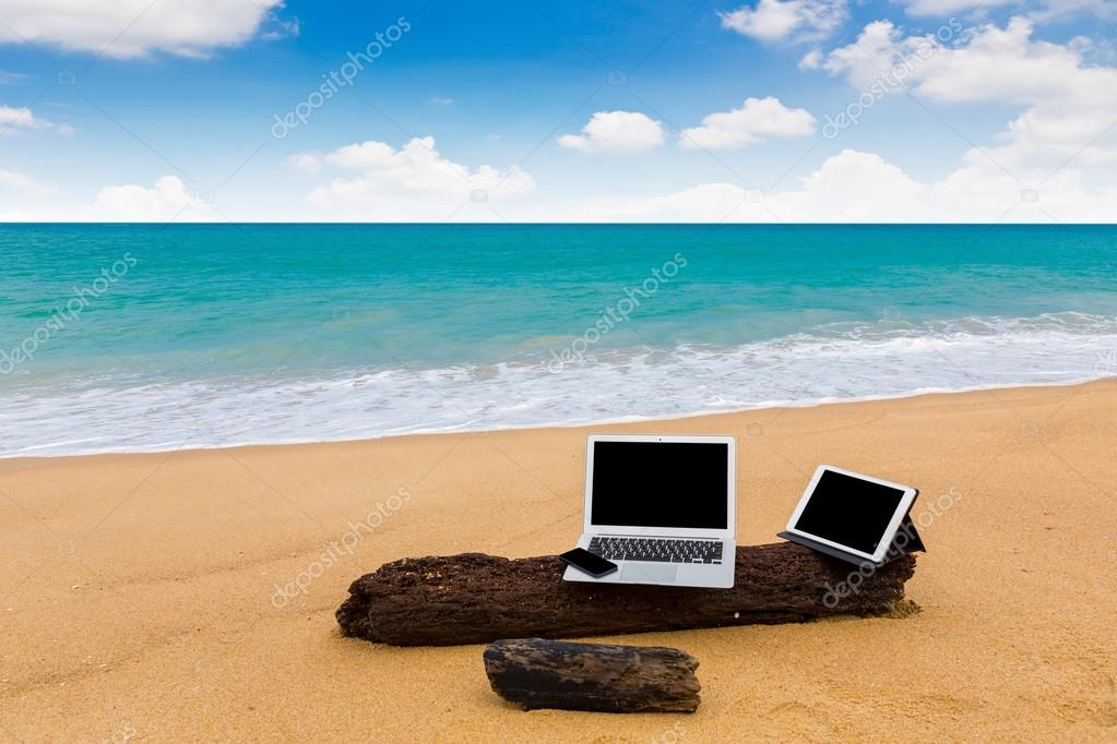 Laptop ,tablet and smartphone on the beach in summer time