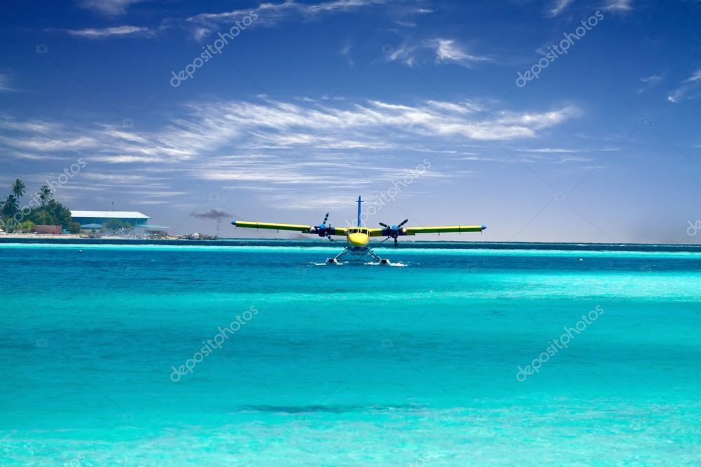 Sea plane taking off in ocean