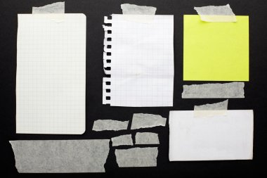 Torn paper scraps set and tape on black background with clipping path stock vector