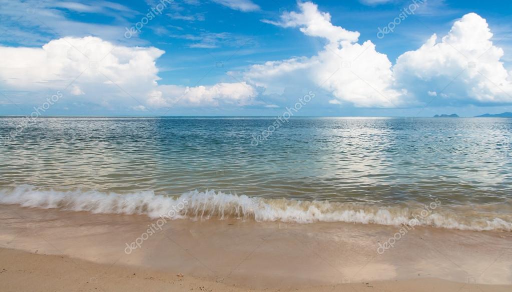 Waving sandy blue sea and sky