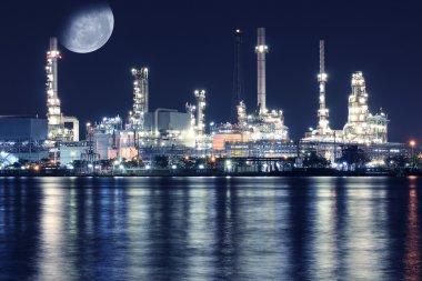 Oil refinery plant night scene