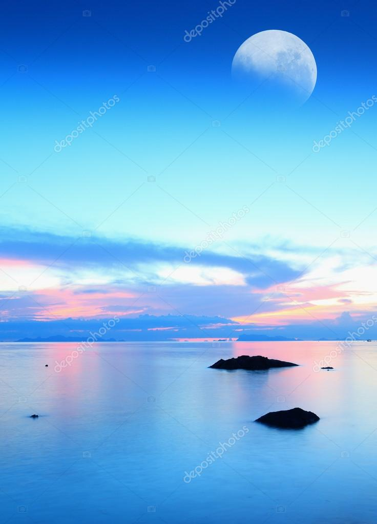 Moon over blue sea and sky