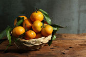 Fotografie Zátiší s mandarinkami v košíku