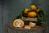 Photo Still life with tangerines in basket