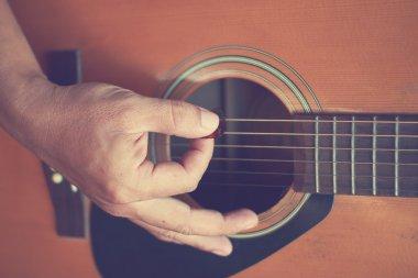 Guitarist plays guitar