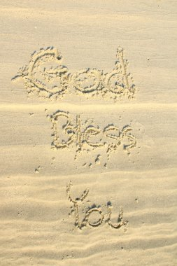 God bless you wrote on sand