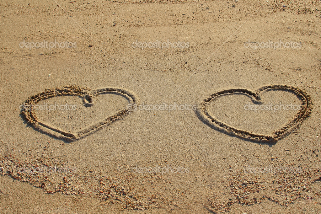 Hearts shape drawn on sand
