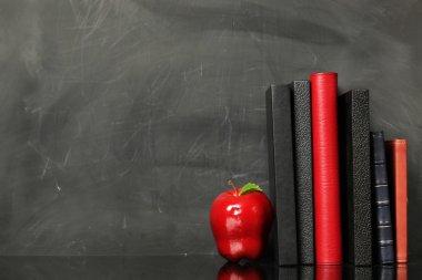 Books against chalkboard