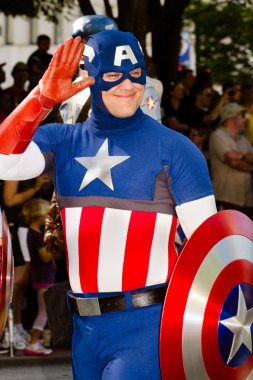 Comic book fan dressed as Captain America in parade