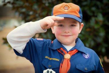 Cub Scout giving Boy Scout salute
