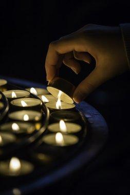 Hand lighting candle
