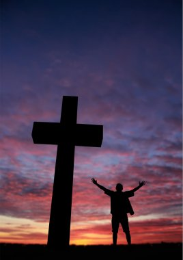 Silhouette of a man at the cross