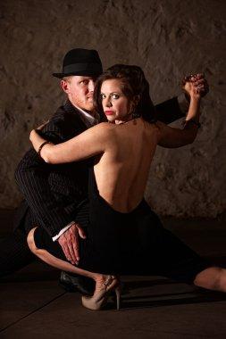 Tango Dancer Holding His Partner