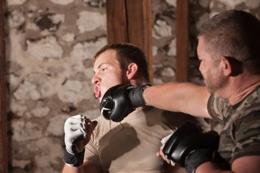 Two Mixed Martial Artists Sparring