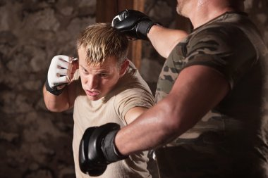 Blond MMA fighter dodges a punch and hits opponent stock vector