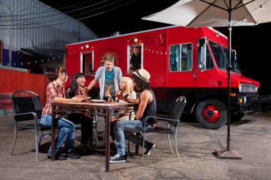 Eating Pizza Near Food Truck