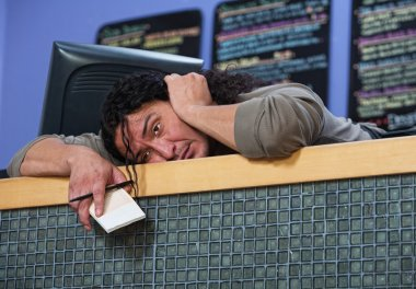 Exhausted Man Laying on Counter