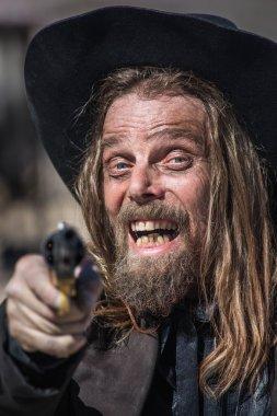 Cowboy Points Gun at You