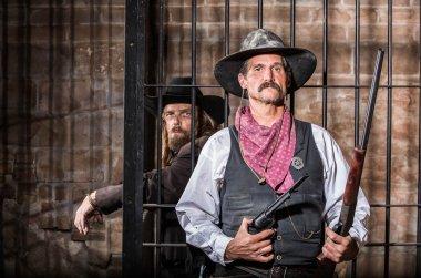 Sheriff Poses With Prisoner
