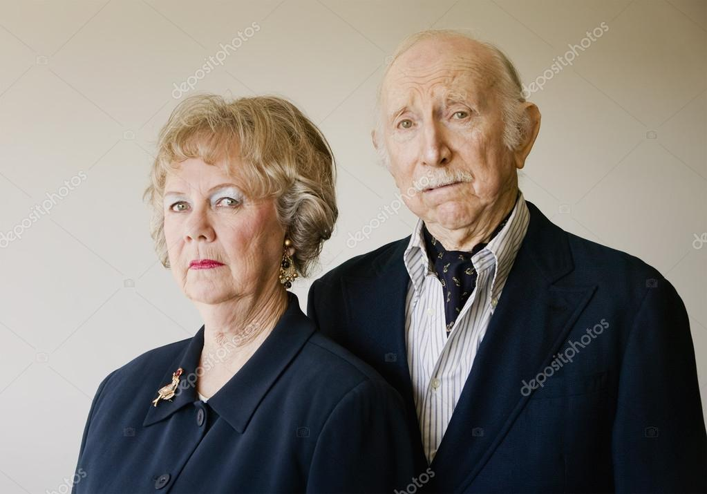 snooty senior couple with strong woman stock photo creatista