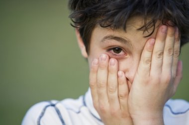 Young Boy Covering His Face