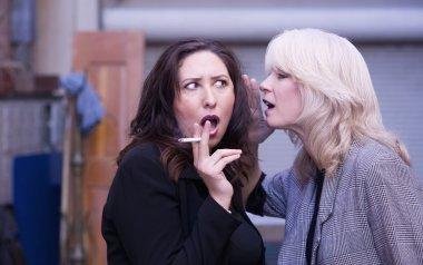 Women Gossip During a Smoking Break