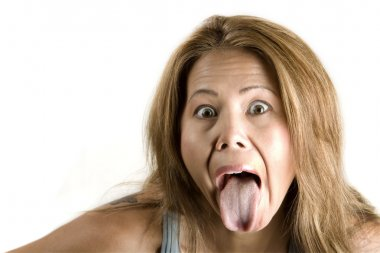 Ethnic woman sticking out her tongue