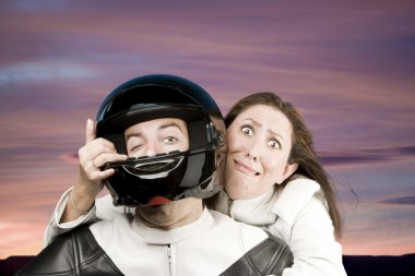 Man and fearful woman on a motorcycle
