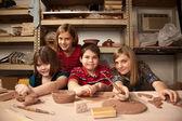 Fotografie Kids in a clay studio